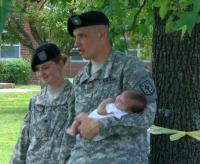 Troops holding baby